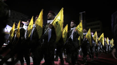 2019 file photo, Hezbollah fighters march at a rally to mark Jerusalem day, in the southern Beirut suburb of Dahiyeh, Lebanon