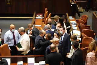 Members of the coalition celebrate in Knesset the passing of the 2021–2022 state budget in first hearing