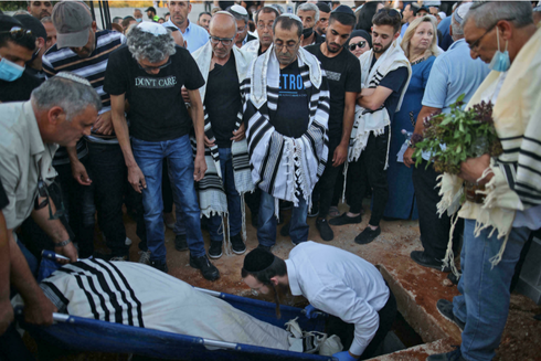 Israeli mourners attend the funeral of Yigal Yehoshua in the city of Modiin on May 18