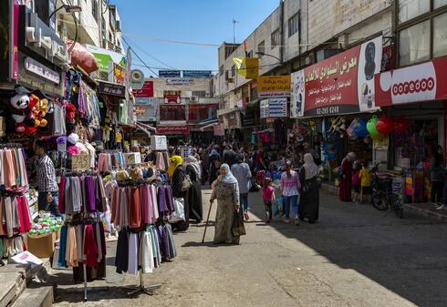 Shoppers on the streets of the West Bank city of Ramallah last year