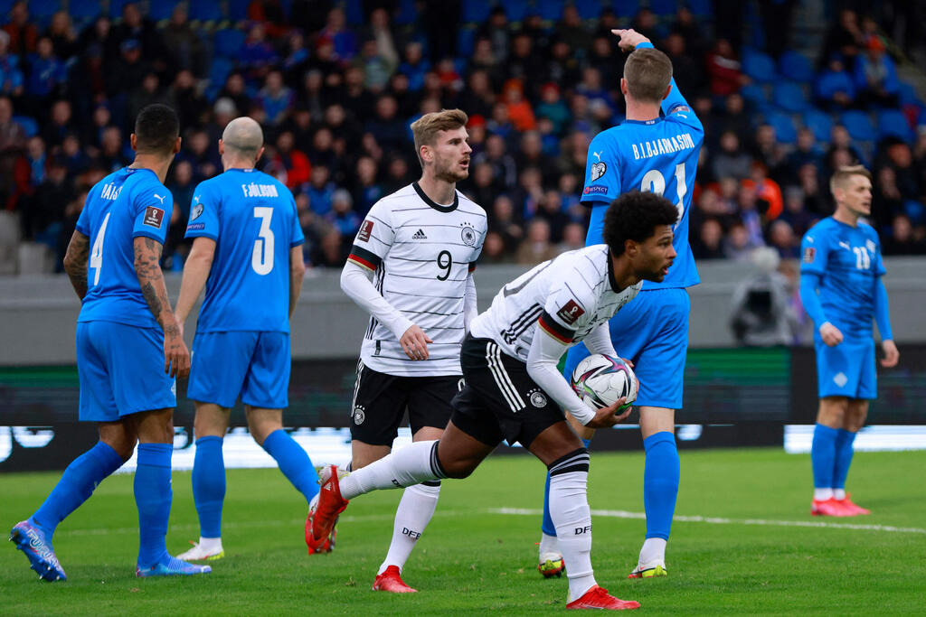 Serge Gnabry and Timo Werner celebrate against Iceland