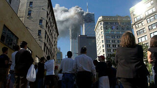 People watch the attack on the World Trade Center in New York