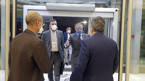 Director General of International Atomic Energy Agency, IAEA, Rafael Mariano Grossi, second right, is welcomed by Deputy Head of the Atomic Energy Organization of Iran