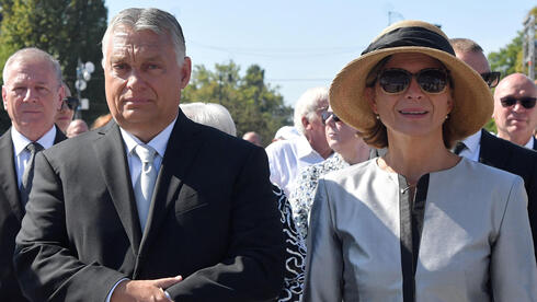 Hungarian Prime Minister Viktor Orban and his wife Aniko Levai wait for the arrival of the Pope to hold a Holy Mass at the end of an International Eucharistic Congress at Heroes' Square in Budapest on September 12, 2021,