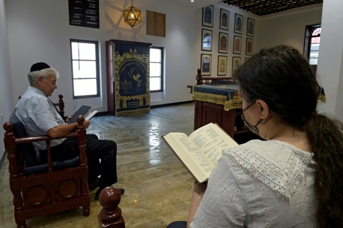 Ebrahim Nonoo, the head of the Jewish Community in Bahrain, prays on the sabbath at the House of Ten Commandments Synagogue in the capital Manama