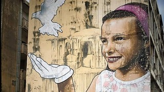 Mr. Dheo's mural on a building damaged in a terrorist attack in Netanya, Israel