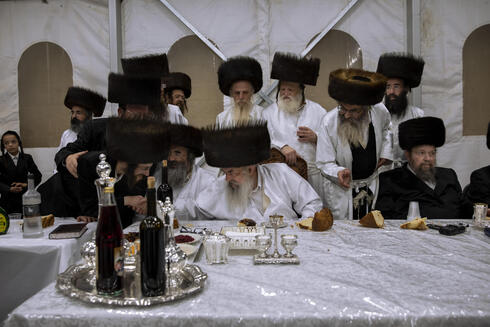 Tabersky, left, blessed by the chief rabbi of the Lelov Hassidic dynasty Aharon Biderman during the pidyon haben ceremony for his son Yossef, in Beit Shemesh, Israel, Thursday, Sept. 16, 2021
