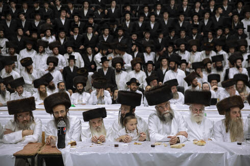 Members of the Lelov Hassidic dynasty attend the pidyon haben ceremony of the great grandchild of their chief rabbi Aharon Biderman in Beit Shemesh, Israel, Thursday, Sept. 16, 2021