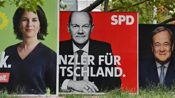 Billboards with election campaign posters showing the three chancellor candidates in the the September 26 federal electio