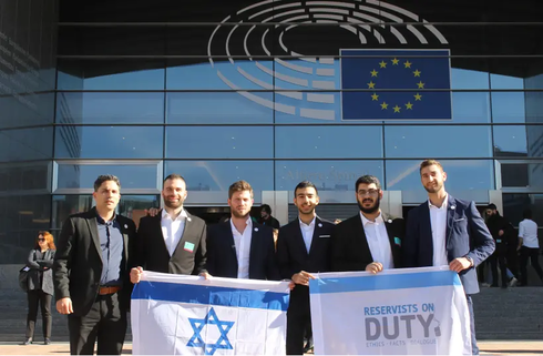 A Reservists on Duty delegation stands outside the EU Parliament in Brussels