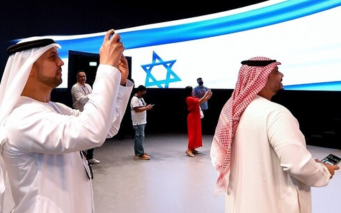 People take pictures in the Israel pavilion during a media tour ahead of the opening of the Dubai Expo 2020 in the Gulf Emirate