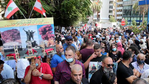 Anti-government activists and families of Beirut Blast victims take part in a protest, in front the Justice Palace in Beirut, Lebanon, 29 September 2021