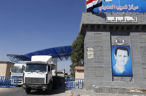 Trucks enter Syria through the Nassib/Jaber border post with Jordan on the day of its reopening, on September 29, 2021, after two months of closure due to fighting in southern Syria