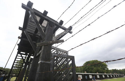 In this July 18, 2017 file photo, the wooden main gate leads into the former Nazi German Stutthof concentration camp in Sztutowo, Poland