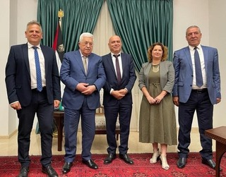 Palestinian President Mahmoud Abbas (center-left) meets with Meretz ministers Nitzan Horowitz (left) and Isawi Frej (center-right) in Ramallah on Sunday