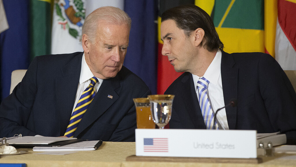 Then-US Vice President Joe Biden, left, talks with State Department Special Envoy for International Energy Affairs Amos Hochstein during the Caribbean Energy Security Summit in 2015