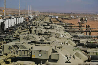 A handout photo made available by the Iranian Army office shows Iranian Army tanks during a military exercise in the north-west of Iran, close to the border with Azerbaijan, October 1, 2021