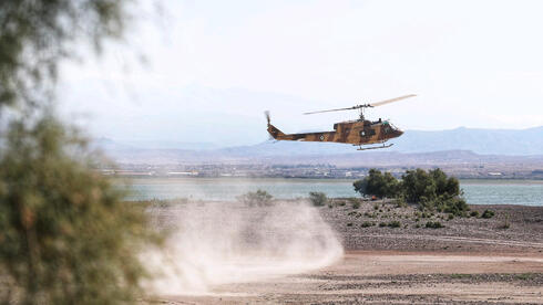A handout photo made available by the Iranian Army office shows an Iranian Army helicopter during an exercise in the north-west of Iran, close to the border with Azerbaijan, October 1, 2021