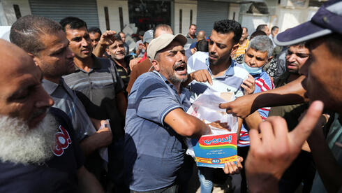 Palestinians gather to apply for Israeli work permits, in Khan Younis, in southern Gaza Strip