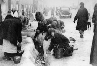 Citizens of Leningrad dig up water from a broken main during the 900-day siege