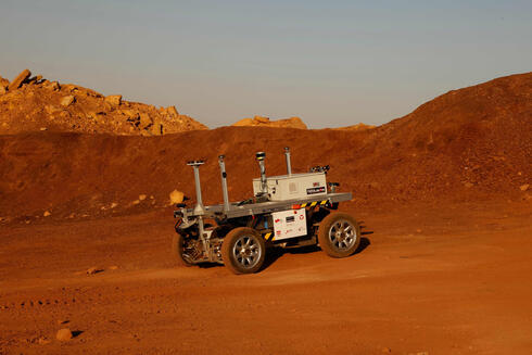 A robotic rover moves during a training mission for planet Mars at a site that simulates an off-site station at the Ramon Crater in Mitzpe Ramon in Israel's southern Negev desert on October 10, 2021