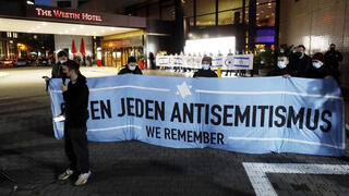 People gather in front of the 'Westin Hotel' in Leipzig, Germany, Tuesday, Oct. 5, 2021 to show solidarity with Jewish musician Gil Ofarim