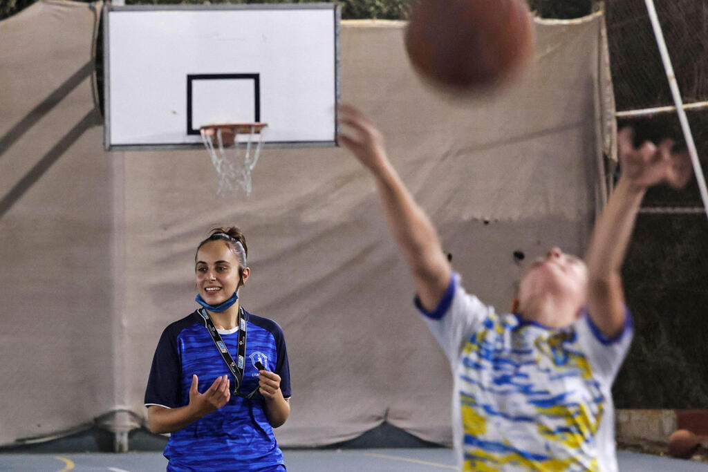 Palestinian referee Amira Ismail leads a basketball training session at Champions Academy in Gaza City