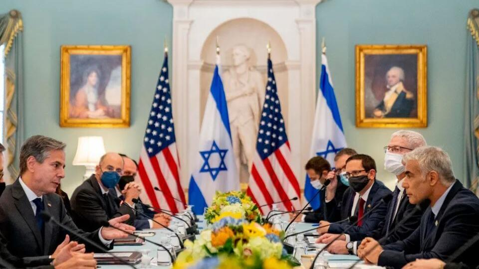 US Secretary of State Antony Blinken, left, accompanied by Israeli Foreign Minister Yair Lapid, right, speaks at bilateral meeting at the State Department in Washington, October 13