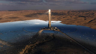 A view of a solar power tower in a solar farm near the Israeli kibbutz Ashalim in the Negev desert, southern Israel, October 23, 2021