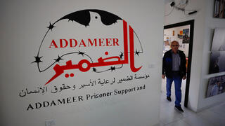 A man works inside the Palestinian civil society group Addameer, which was designated by Israel as a terrorist organization along with other five groups, in Ramallah