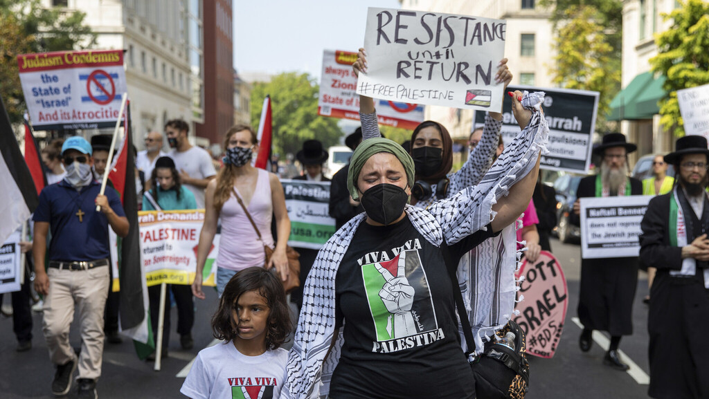 Pro-Palestinian protesters march outside the White House