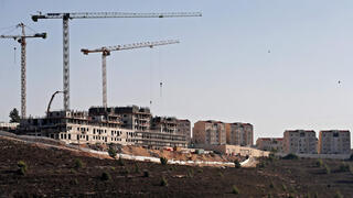 construction work in the Jewish settlement of Givat Zeev, near the Israeli-occupied West Bank city of Ramallah